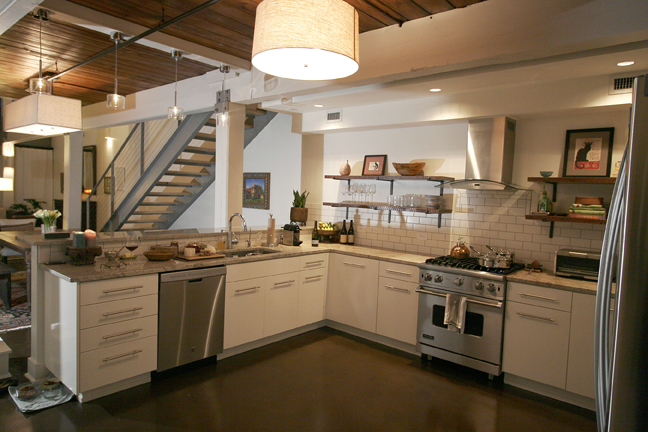 Chic urban industrial kitchen in open concept riverfront for Open concept loft