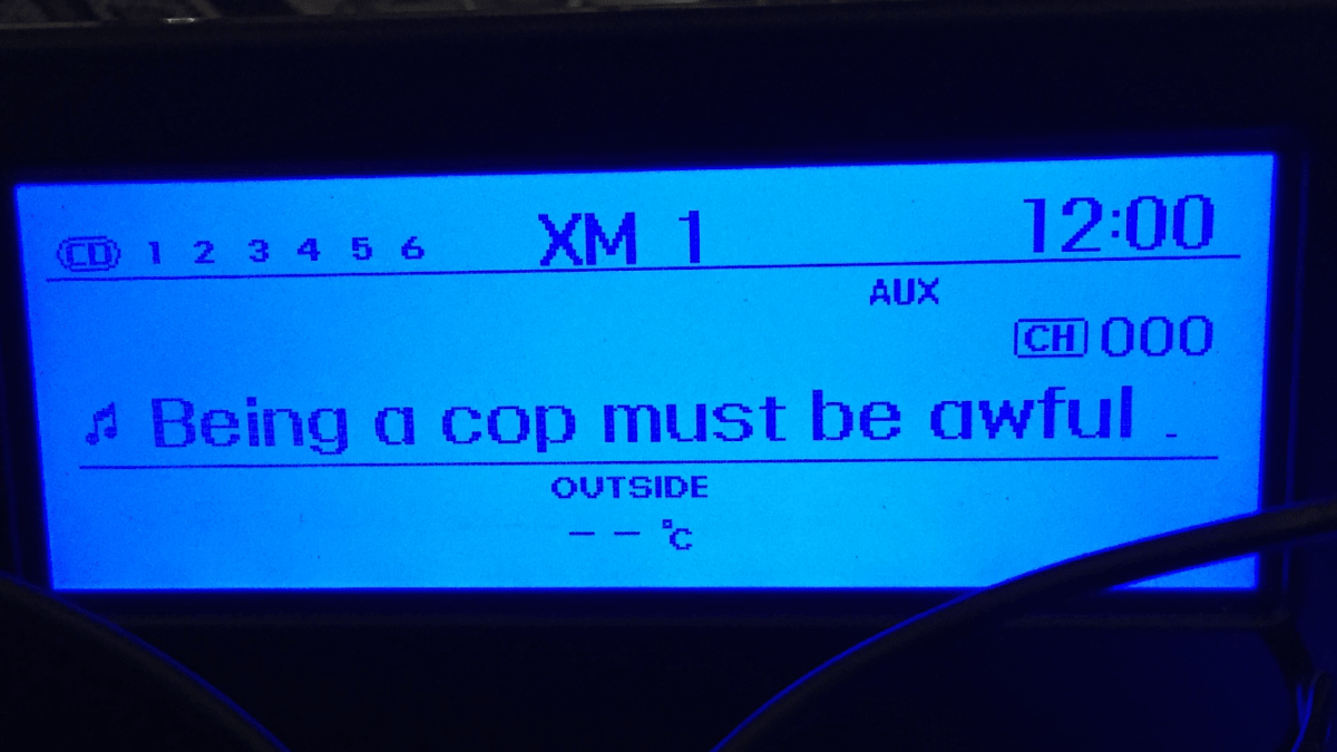 "Reddit's ""shower thoughts"" on my car's factory radio screen."