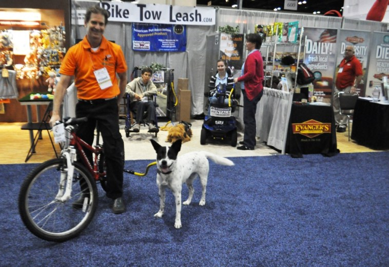 Mike Leon, Creator of the Bike Tow Leash Dog-Cycling Bike Attachment, Demonstrates How It's Used during Global Pet Expo in Orlando, Fla., March 13, 2014