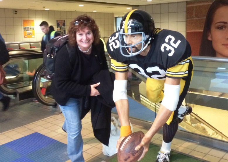 """That's me! At the Pittsburgh International Airport with the statue commemorating the 1972 """"Immaculate Reception."""""""