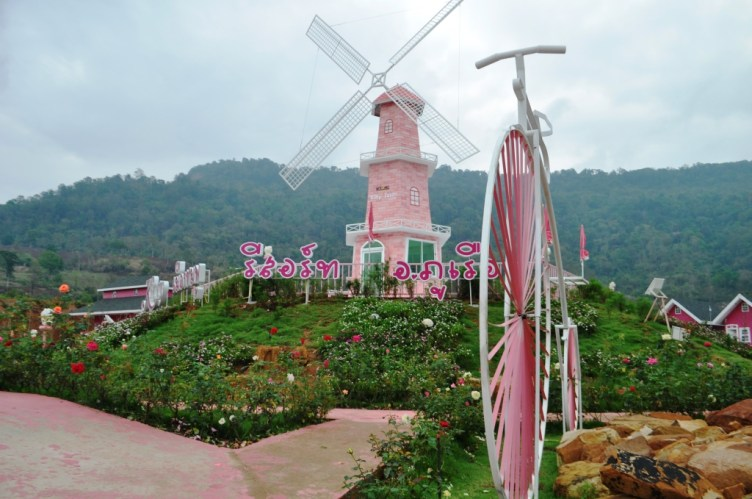 Windmill and Penny-farthing at the Kitty Resort in the Loei Province of Thailand, March 2015