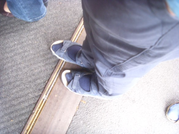 The tourist shuffle!  My sister's foot just edging over the threshold of the ticket office!