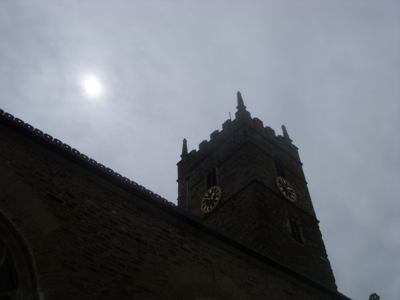 Sun breaking through the clouds over the tower - heralding a dryer afternoon ahead.