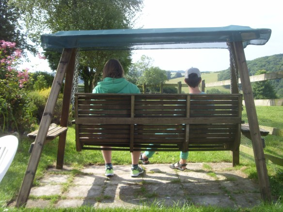 Tom and Tobias on the swing seat at War Horse Valley Country Farm Park Iddesleigh