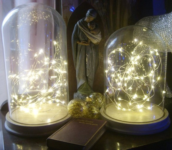 Although he isn't here - he is. I just have to look at these cloche lights that he gave me as a pre-Christmas present - and each little light reminds me of all the hours of work that he has put in to