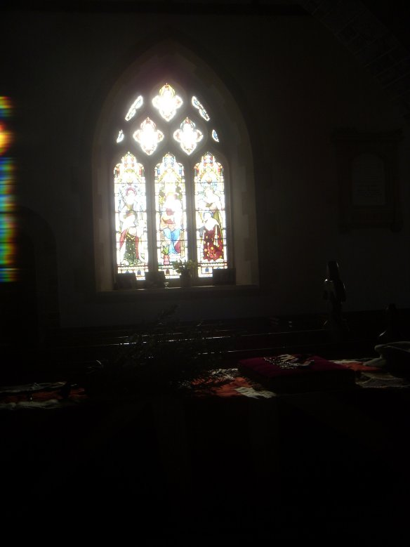 I love the rainbow colours of light on the left of this picture. That is the light streaming through the alter window.
