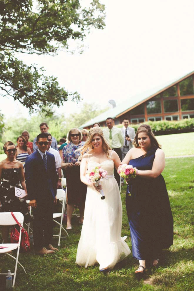 Sister walking the bride down the aisle