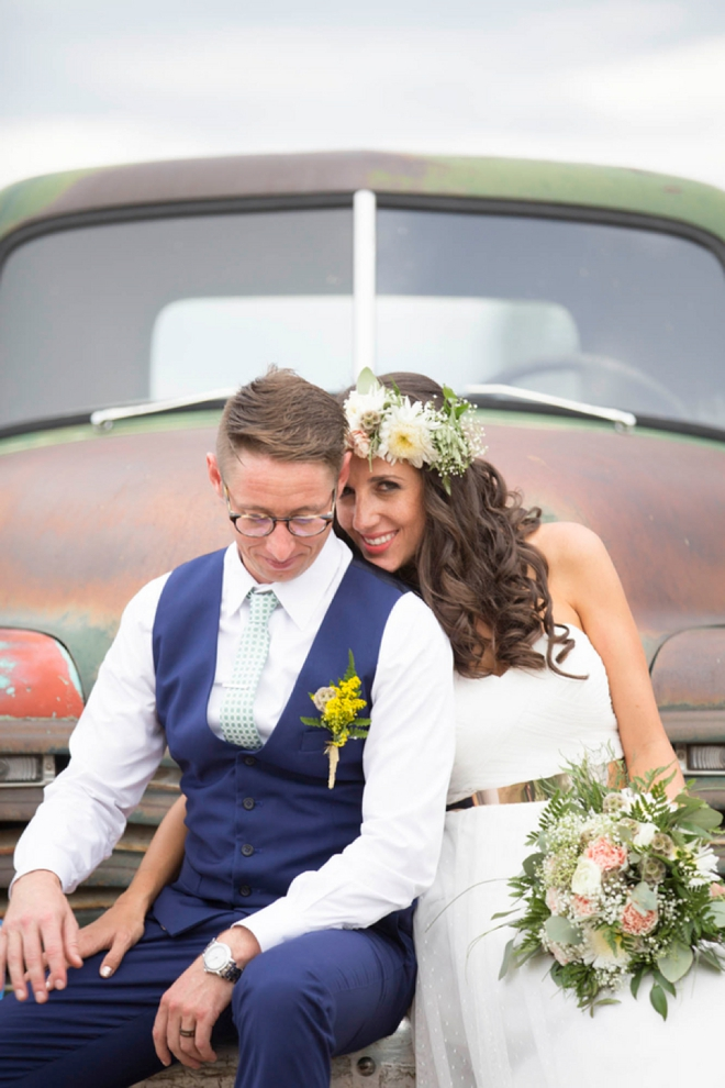 Bride and groom sitting on an old truck