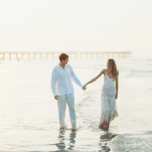Gorgeous, sunrise beach engagement session by JOPHOTO