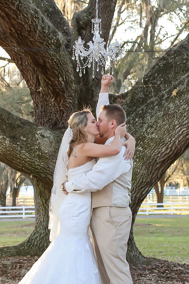 First kiss as Mr. and Mrs. at this stunning outdoor ceremony!