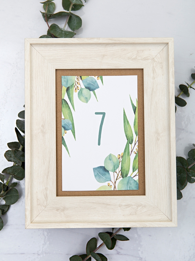 Darling free printable table numbers with a eucalyptus theme!