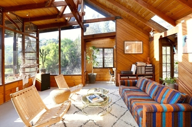 Living room with vaulted ceiling and views