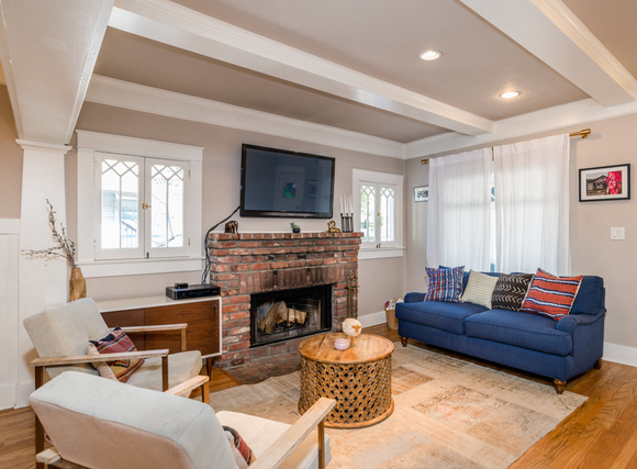 Living room with original windows, wood floors and fireplace
