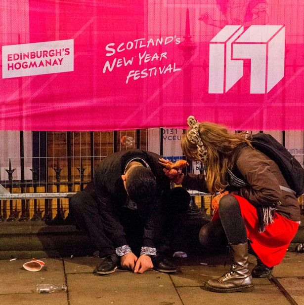 revelers-descend-on-edinburghs-city-centre-to-bring-in-the-new-year-in-edinburgh-scotland-4