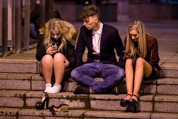 revelers-descend-on-edinburghs-city-centre-to-bring-in-the-new-year-in-edinburgh-scotland