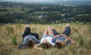 people-lying-down-field