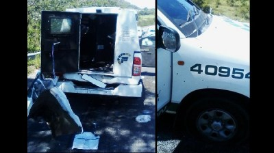 Cash-in-transit vehicle shot and bombed - photos