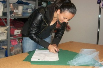Felicia Richardson, junior, is starting her prom dress by using a marking tool to outline her pattern piece for the challenge.Photo Credit: Saron Abraham