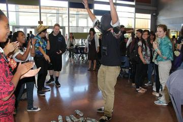 """Senior Jean-Paul Torres cheers when he realizes that he has knocked down all of the water bottles for Tuesday's """"pantyhose"""" lunch game.Photo Credit: Michelle Manuel"""