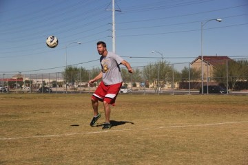 "Mr. Jeffrey Ball practices for tomorrow's student vs. staff soccer game. The event was organized to boost the school's enthusiasm about soccer. ""I'm excited for tomorrow's game and hopefully the students will enjoy it too. We're not taking it too seriously, but we're going to try to beat the otter team,"" Ball said. 