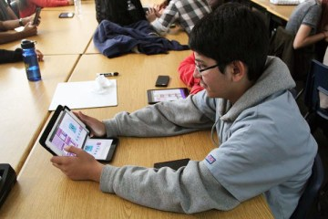 """Sophomore Hassan Bhatti creates his own gif as part of the second activity of the hour of code. Students participated in coding activities such as playing angry birds. """"I enjoyed learning how to code because even though I don't use it, it's still a good skill to learn,""""Bhatti said. Photo Credit: Emily Yu"""