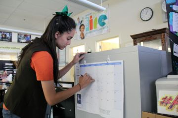 "After reviewing the early start calendar, senior Ashlee Rodriguez schedules the year on a calendar. Trustees are seeking input by May 26 to take it into account before the vote on May 28. ""I don't see anything bad about the early start calendar because summer would start earlier,"" Rodriguez said."
