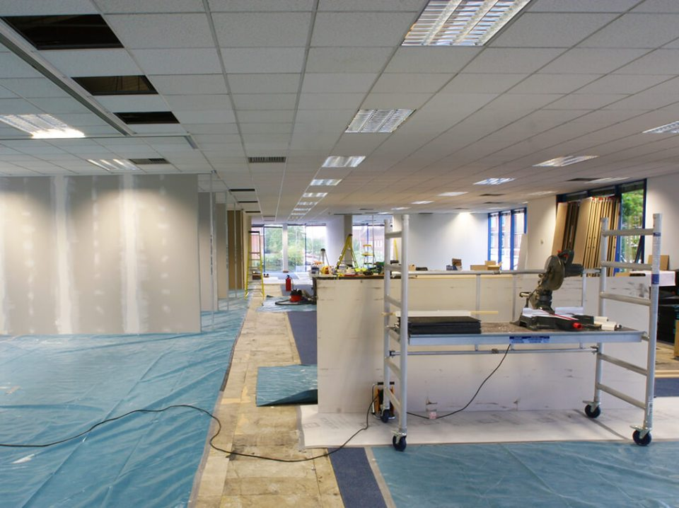 Image of the installation of a Treetex commercial suspended ceiling tile grid