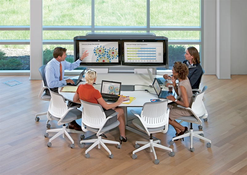 Picture of staff working in a collaborative workspace tele-conferencing office