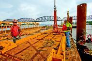 Jesse Jones Jack Klongz and Joe Combs on work barge with tower crane motor deck components.