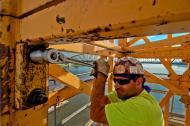 Joe Combs tightens a connector pin bolt.