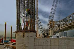Ironworkers working inside a caisson for the Downtown Span
