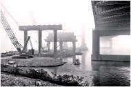 A foggy morning as the crew boat navigates alongside Pier Seven of the Downtown Span on the Ohio River Bridges Project in Louisville, Kentucky. (Processed with Topaz B&W Effects)