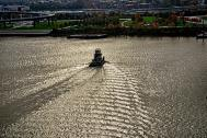 Towboat Kathleen Ohara heads for Kentucky shore of Ohio River in Louisville, Kentucky,