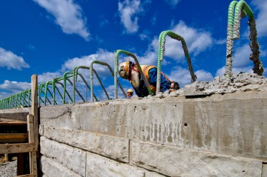 Jimbo Clark ties rebar on the Ohio River Bridges Project