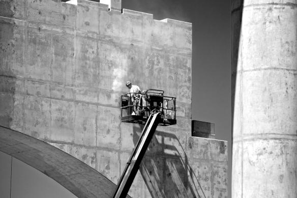Concrete finisher at work on surface of bridge anchor. #1 B&W Version