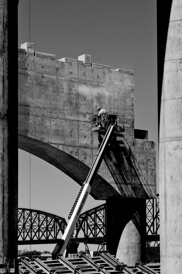 Concrete finisher at work on surface of bridge anchor. #3 B&W Version