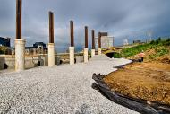 Pilings and backfill for a MSE wall being built along the south side of Jefferson Street and Preston Street in Louisville, KY.