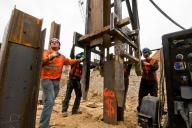 Pile driving crew placing a piling section for welding before driving further into the earth. #3