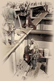 Ironworkers George Nichols and Zach Williams at work assembling another section of the Downtown Span on the Ohio River Bridges Project in Louisville, KY B&W Version