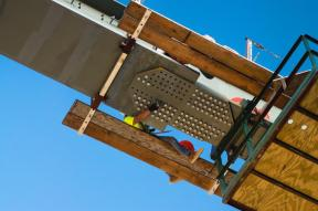 Ironworker, Trey Dewitt, bolting the side girder in place.