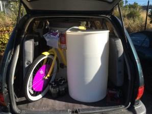 Delivering water barrels and bike