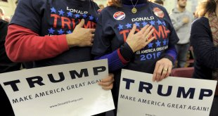 Supporters of U.S. Republican presidential candidate Donald Trump hold their hands to their chest as the national anthem is played at a campaign rally in Concord, New Hampshire January 18, 2016.      REUTERS/Gretchen Ertl/File photo
