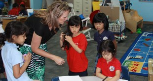 Kelli Czaykowsky assists refugee children at a Seventh-day Adventist school in Duluth, Ga., on May 14, 2015. Photo courtesy of Allen Clark