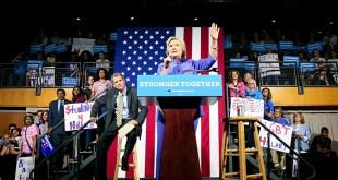 Presumptive Democratic presidential nominee Hillary Clinton speaks as U.S. Senator Sherrod Brown listens at the campus of the University of Cincinnati in Cincinnati, Ohio, July 18, 2016. REUTERS/William Philpott - RTSILR1