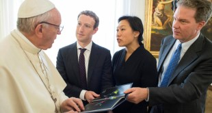 Pope Francis talks to Facebook CEO Mark Zuckerberg, second from left, and Priscilla Chan, Zuckerberg's wife, during a meeting at the Vatican on August 29, 2016. Vatican spokesman Greg Burke is at far right. Photo courtesy of Reuters via Osservatore Romano