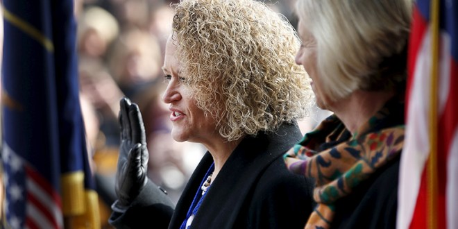Jackie Biskupski, left, is sworn in as mayor as her finance Betty Iverson watches at Salt Lake City, Utah, on January 4, 2016. The former state lawmaker is the first openly gay person to hold the office. Photo courtesy of REUTERS/George Frey