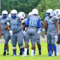 Minneapolis North quarterback Tyler Johnson (10) gives instructions to his teammates during a game.