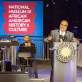 Lonnie Bunch, the founding director of the Smithsonian Institution's National Museum of African American History and Culture welcomes guests to the museum's special ceremony outside of the Smithsonian's newest museum that is scheduled to open in Fall 2016.