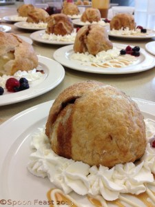 Serve warm  Apple Dumplings with whipped cream and caramel sauce. A few fresh berries add color to the plate.