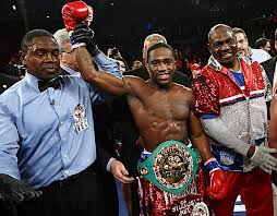 WBA lightweight champion Adrian Broner celebrates his latest TKO victory (Credit: AP Photo)